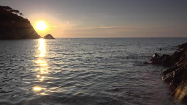 pan / sunset at rocky coast - island of elba stock videos & royalty-free footage