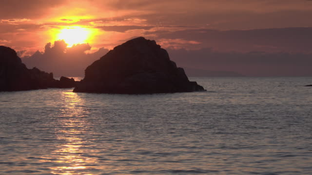 sunset at rocky coast - island of elba stock videos & royalty-free footage