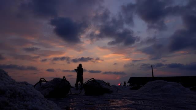 sunset at salt farming - pond stock videos & royalty-free footage