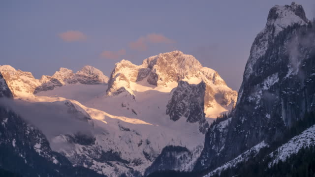 tl sunset at the mighty dachstein mountains - dachstein mountains stock videos and b-roll footage