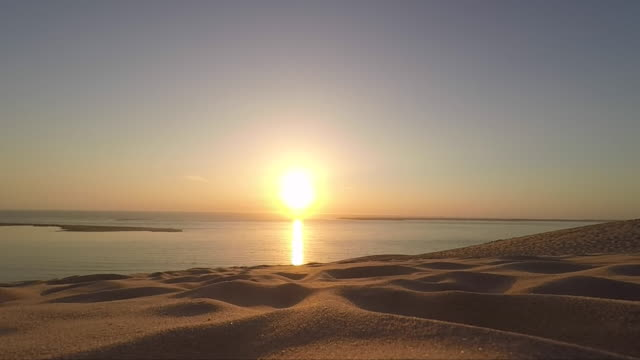 sunset at the seaside, dune of pilat - dune of pilat stock videos and b-roll footage