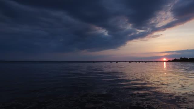 sunset at the seaside - knochen im beckenbereich stock-videos und b-roll-filmmaterial