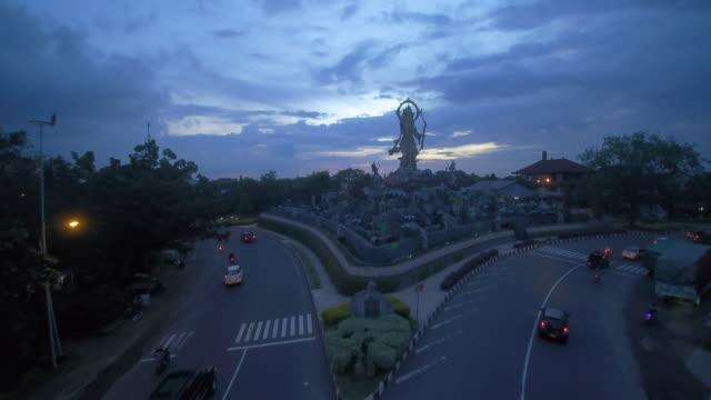 stockvideo's en b-roll-footage met sunset at titi banda statue bali indonesia - vork