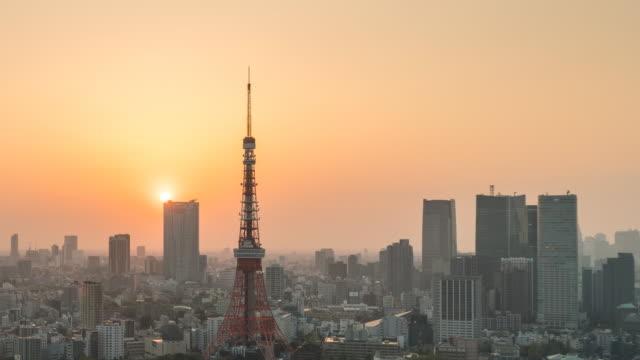 sunset at tokyo tower - tokyo japan stock videos & royalty-free footage