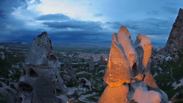 sunset at uchisar castle - cappadocia stock videos and b-roll footage