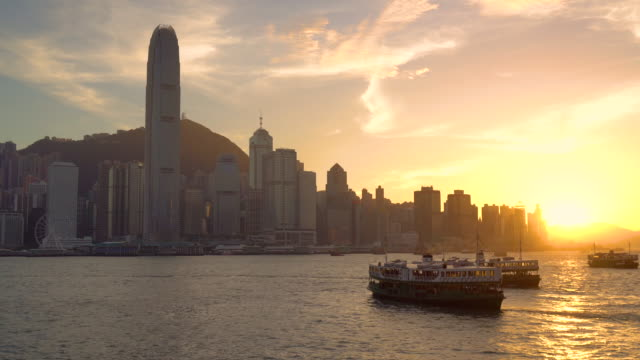 stockvideo's en b-roll-footage met zonsondergang op de victoria harbour - star ferry