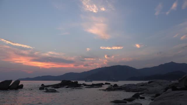 pan / sunset at villasimius beach - spiaggia stock videos & royalty-free footage