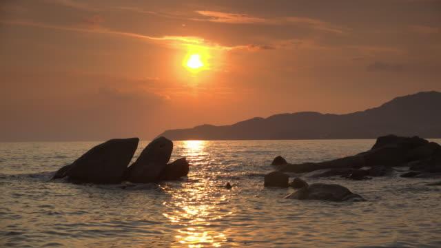 sunset at villasimius beach - spiaggia stock videos & royalty-free footage