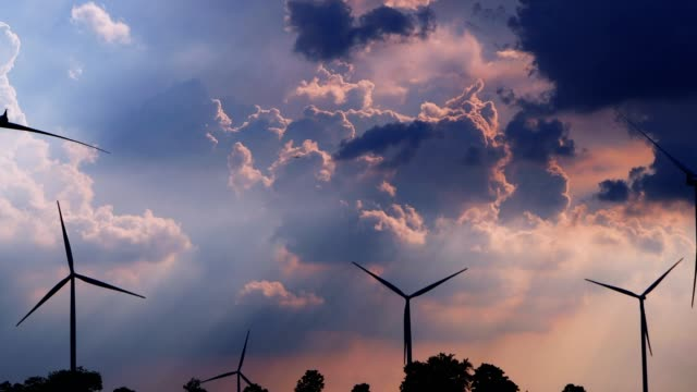 sunset at wind turbine power generator farm. - fuel crisis stock videos and b-roll footage