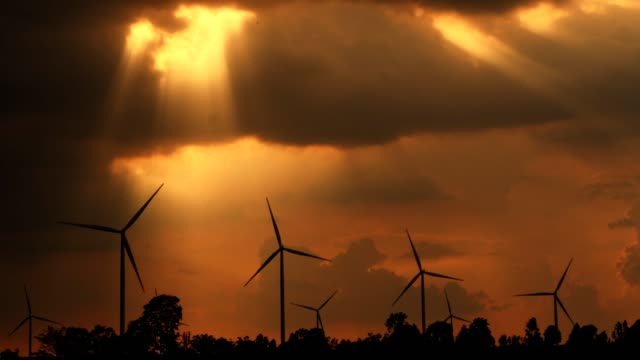 sunset at wind turbine power generator farm. - generator stock videos and b-roll footage
