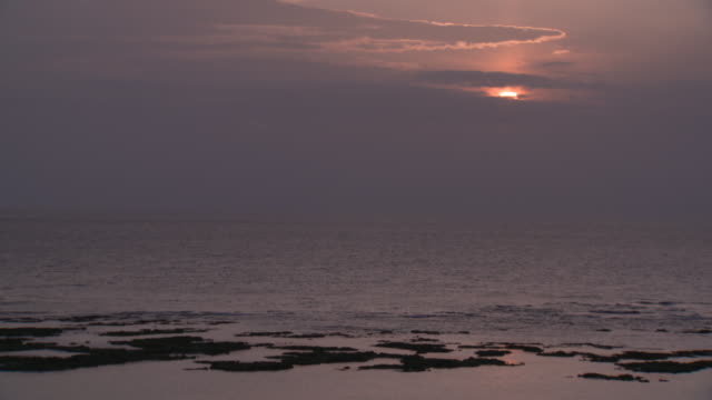 sunset at yonama beach in tokunoshima island - south pacific ocean stock-videos und b-roll-filmmaterial