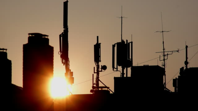 t/l sunset behind base station antennas - repeater tower stock videos and b-roll footage