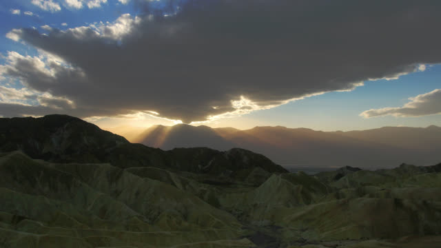 time lapse wide shot sunset behind clouds over mountains of death valley national park, nevada - nevada stock videos & royalty-free footage