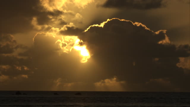 Sunset behind clouds over ocean, Fakarava Atoll, French Polynesia