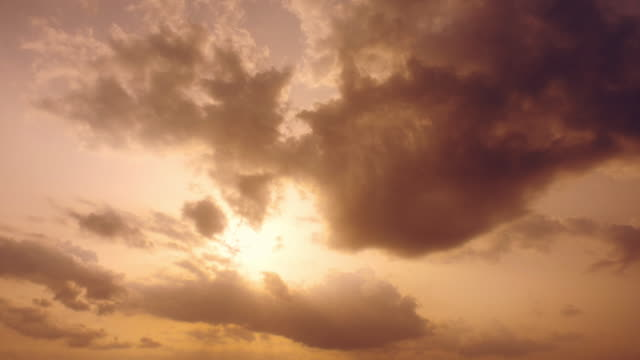 sunset behind clouds with god rays - high contrast stock videos & royalty-free footage