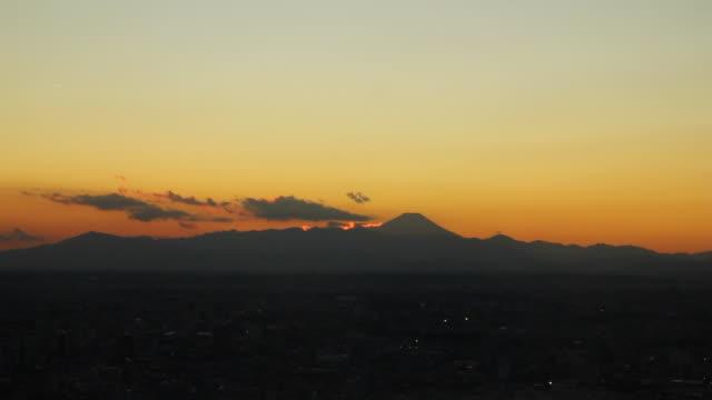 sunset behind mt. fuji, wide shot - kanto region stock videos & royalty-free footage