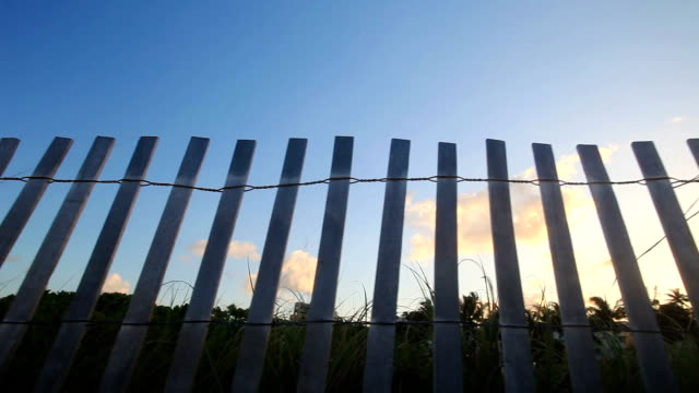 sunset behind the fence - picket fence stock videos and b-roll footage