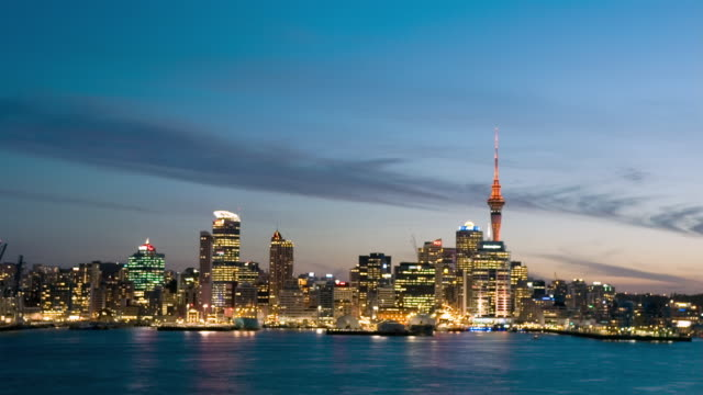 ws t/l sunset behind waitemata harbour and cityscape/ auckland, new zealand  - auckland stock videos & royalty-free footage