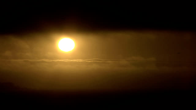 sunset between clouds, timelapse - stratus stock videos & royalty-free footage