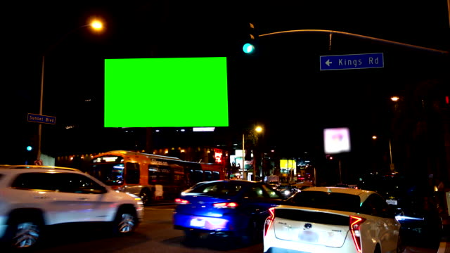 sunset blvd los angeles traffic green screen chromakey - billboard stock videos & royalty-free footage