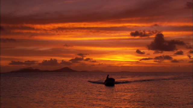 Sunset, boat to camera, Chuuk Lagoon, South Pacific