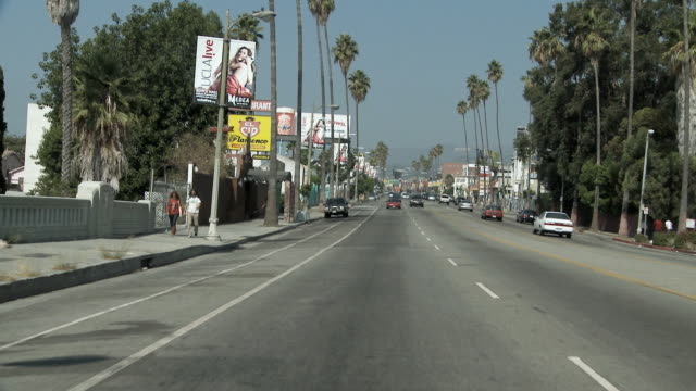 ws pov sunset boulevard in silver lake neighborhood / los angeles, california, usa  - sunset boulevard stock-videos und b-roll-filmmaterial