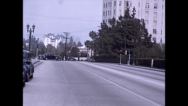 sunset boulevard looking towards the chateau marmont hotel in the distance with the sunset tower on the right / other properties including 8433... - 1930 1939 stock-videos und b-roll-filmmaterial