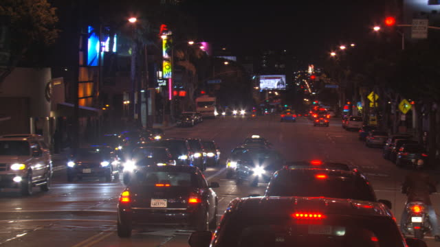 Sunset Boulevard traffic at night; driver's POV