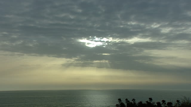 sunset byblos zi to sunbeams peaking through a grey cloudy sky over the mediterranean sea - sunbeam stock videos & royalty-free footage