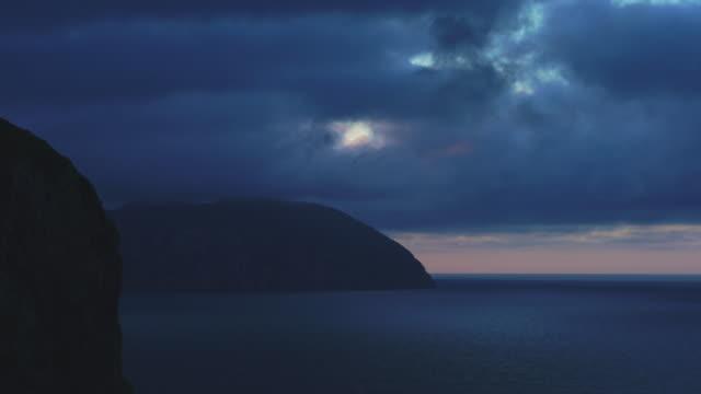 sunset, cantabrian sea, liendo valley, montaña oriental costera, cantabria, spain, europe - 2匹点の映像素材/bロール
