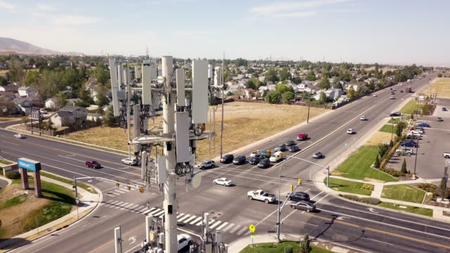 5g sunset cell tower: cellular communications tower for mobile phone and video data transmission - tower stock videos & royalty-free footage
