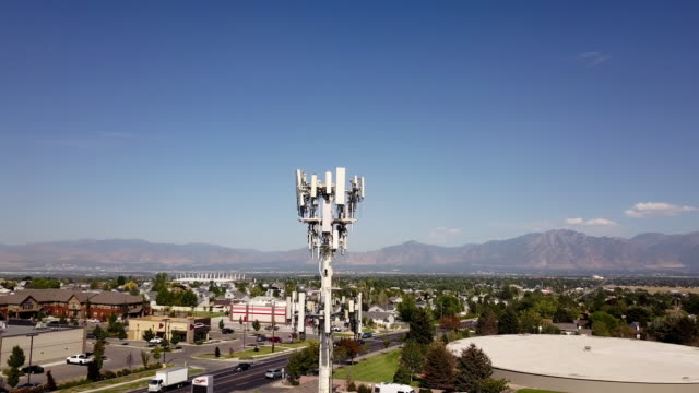 5g sunset cell tower: cellular communications tower for mobile phone and video data transmission - communications tower stock videos & royalty-free footage