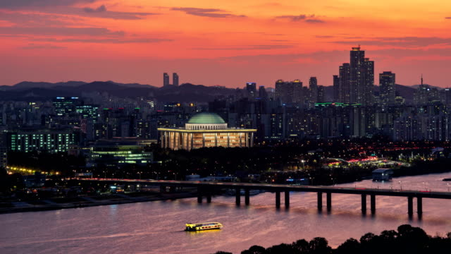 sunset cityscape of han river and national assembly building / yeouido, seoul, south korea - national assembly stock videos & royalty-free footage