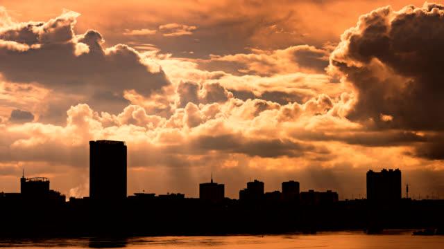Sunset cityscape on riverside 4K UHD