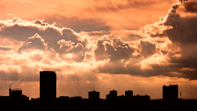 sunset cityscape translation 4k dci - extreme weather stock videos & royalty-free footage