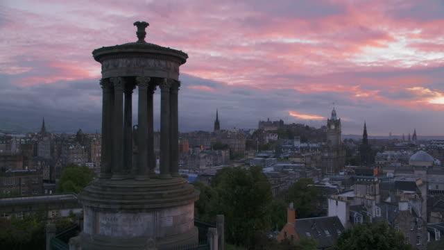 Sunset clouds over Edinburgh skyline (Edinburgh castle and old city) seen from Calton hill.