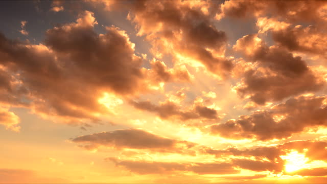 sunset clouds - sunlight stock videos & royalty-free footage