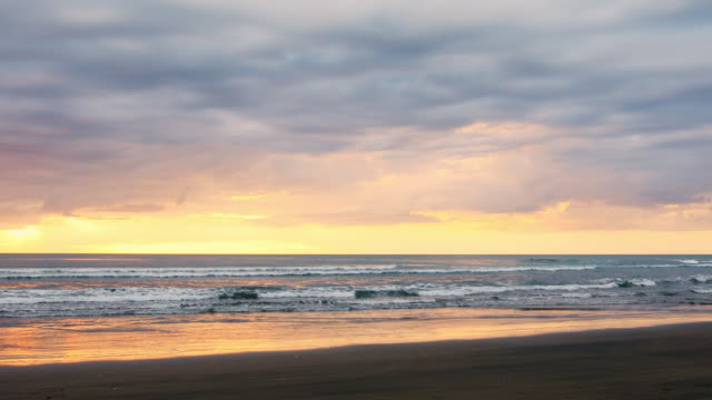 Sunset Cloudscape Over a Pristine New Zealand Beach