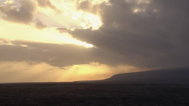 Sunset coastline at Hawaii Volcanoes National Park.