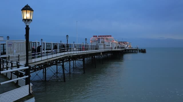 sunset colours over worthing pier, worthing town, west sussex, england, uk - west sussex stock videos & royalty-free footage