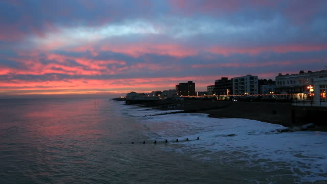 sunset colours over worthing promenade, worthing town, west sussex, england, uk - promenade stock videos & royalty-free footage