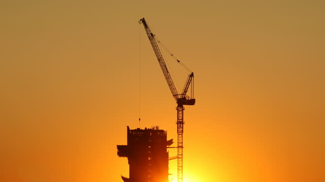 sunset construction - crane stock videos & royalty-free footage