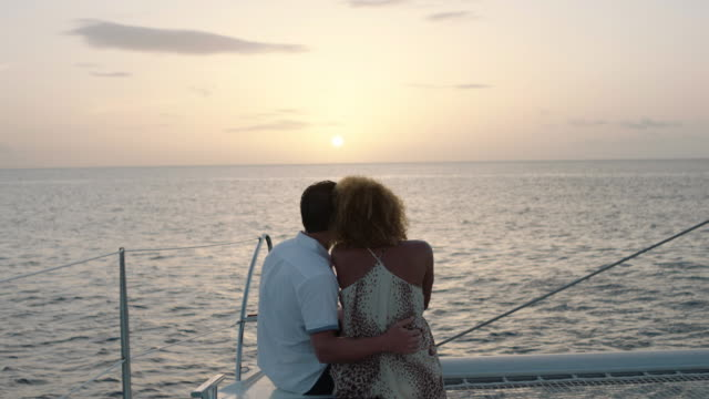 sunset couple - boat point of view stock videos & royalty-free footage