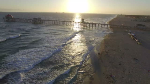 sunset drone shot of the pier in huntington beach - pier stock videos & royalty-free footage