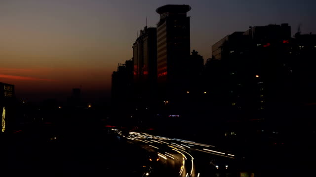 sunset during city rush time lapse - rx stock videos & royalty-free footage