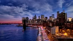 Sunset, dusk and night over the Lower Manhattan