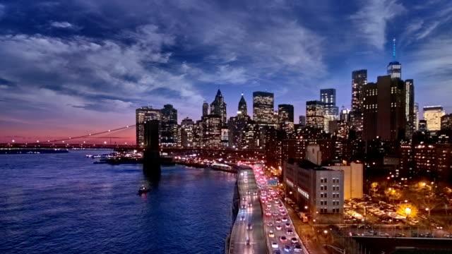 Solnedgång, skymning och natt över de nedre Manhattan