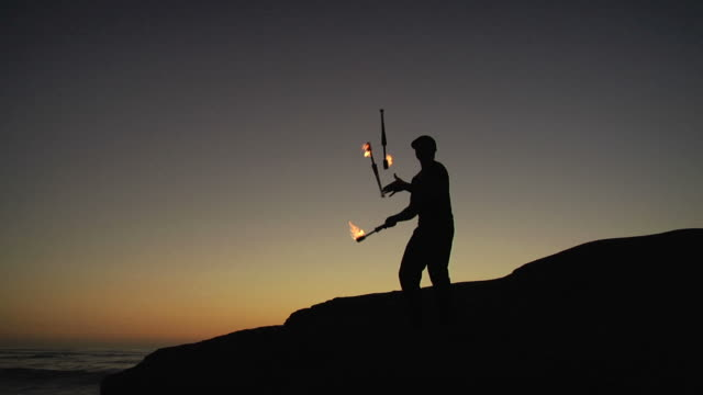 sunset fire juggling - juggler stock videos and b-roll footage