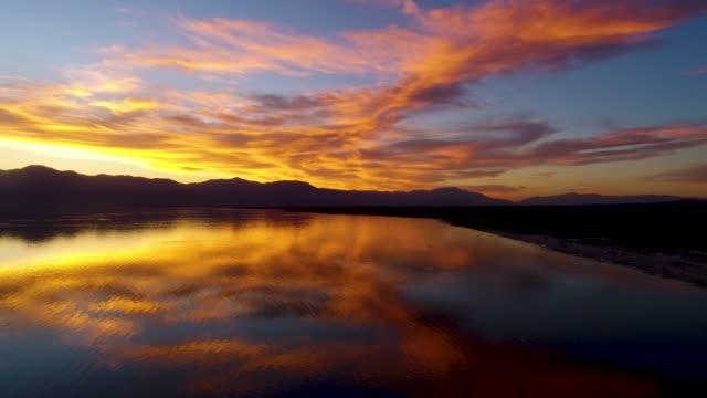 sunset flight over the salton sea - riverside california stock videos and b-roll footage