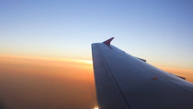 sunset flight - aircraft wing stock videos & royalty-free footage